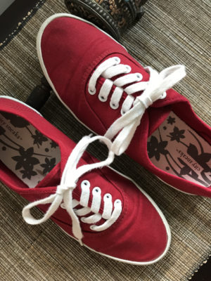 Stylish, comfortable shoes for women over 40: red sneakers