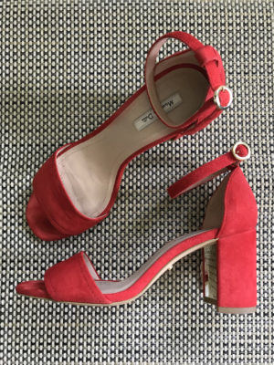 Stylish, comfortable shoes for women over 40: red suede sandals with block heels