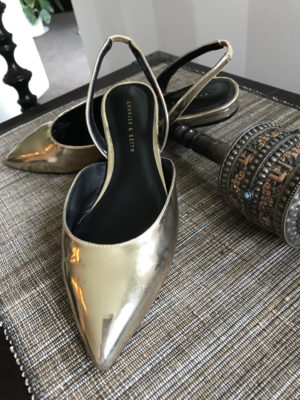 Stylish, comfortable shoes for women over 40: gold flats with sling backs