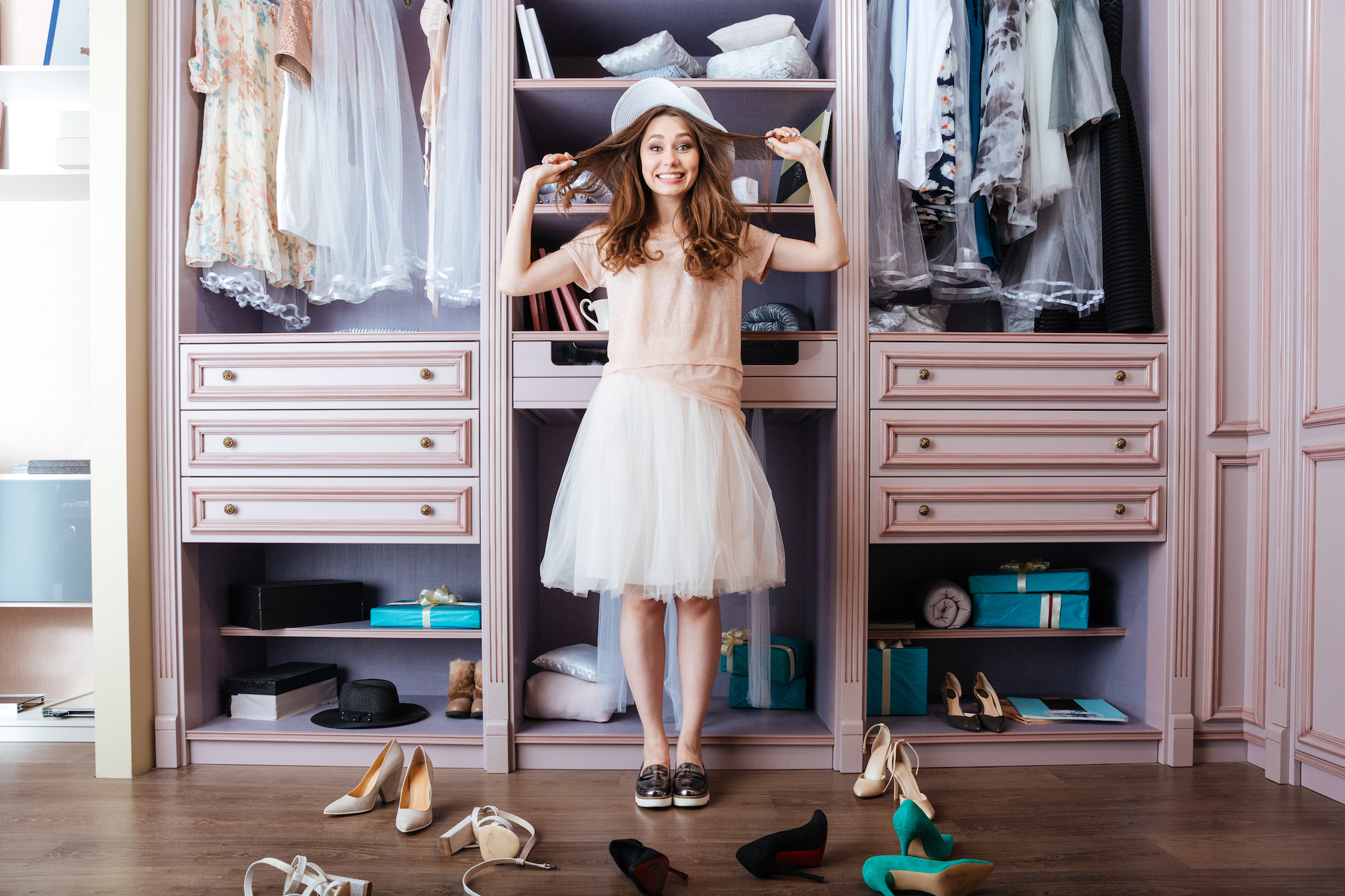 Girl standing in front of wardrobe deciding which shoes to wear
