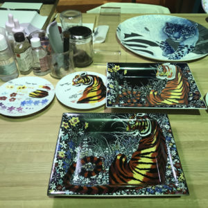 A selection of hand painted porcelain plates