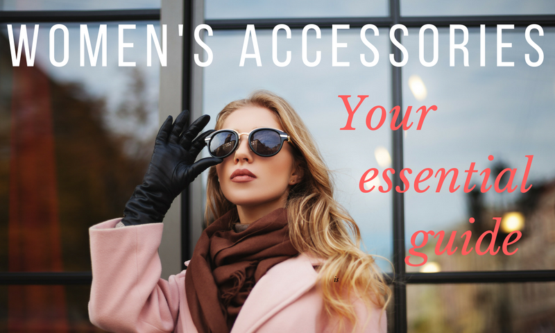 Woman wearing women's accessories including sunglasses, scarf and gloves.