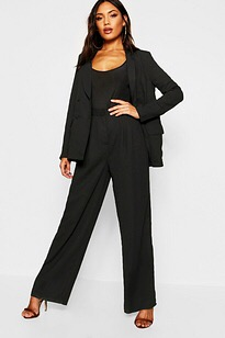 Black palazzo pants teamed with a black top and high heels makes the wearer look taller and slimmer