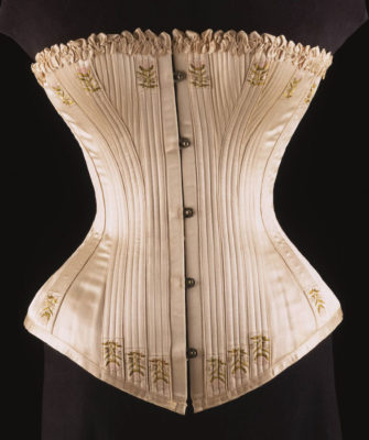 Underwear Essentials blog. Picture shows ivory silk satin and whalebone corset circa 1900