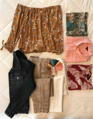 Step two in the travel packing capsule wardrobe is to add four tops to the two pairs of pants and the jacket.