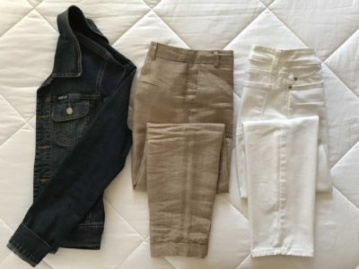Choosing neutral coloured pants and a jacket are the first step in a travel packing capsule wardrobe.