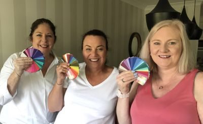 Three ladies showing swatches of their best colours after attending the Personal Colour Analysis Workshop