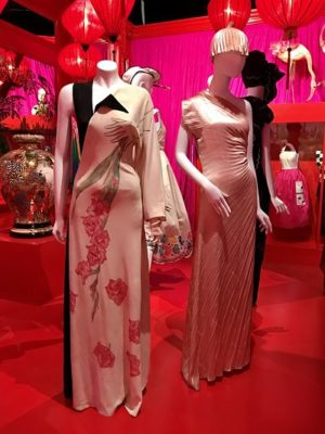 Glamorous evening gowns inside the mockup of Jenny Kee's store, Flamingo Park.