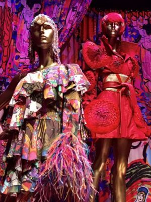 Mannequins wearing colourful dresses.