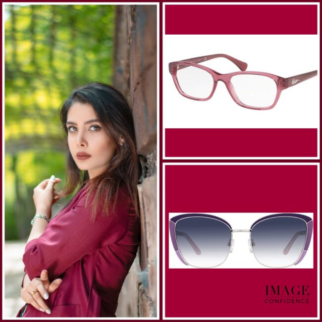 Woman wearing maroon top with two pairs of glasses that suit her cool colouring.