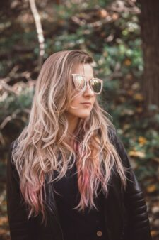 Girl wears rose beige coloured glasses to match her hair colour.